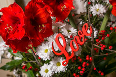 red-flowers-wooden-sign-love-romantic-installation-bridal-bouquet-st-valentines-day-49826752.jpg