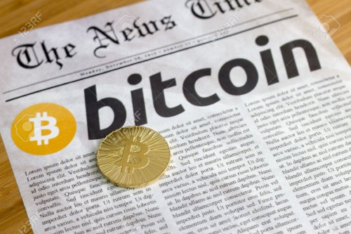 52701747-Bitcoin-on-newspaper-background-Stock-Photo.jpg