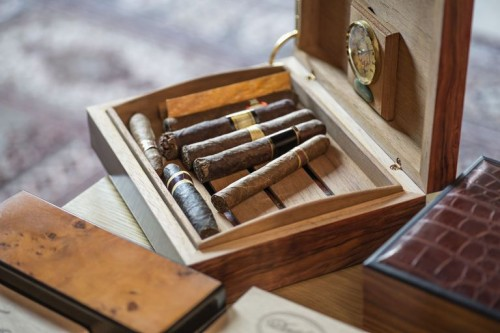 high-angle-view-of-cigars-in-wooden-box-on-table-515789209-57bdba133df78c8763ff53d8.jpg